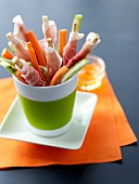 Breadsticks wrapped in Aoste ham and raw vegetables for an aperitif