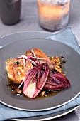 Roasted guinea-fowl with red chicory and braised Carmines