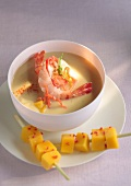 Cream of coconut soup with shrimps and mango