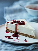 Slice of cheesecake with pomegranate sauce