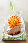 Chocolate ice cream quenelle and a caramel sun