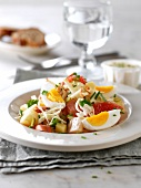Potato, apple, Frankfurt sausage, grapefruit, hard-boiled egg and Emmental salad