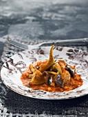 Artichoke and sardine stew