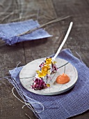 Pitahaya and sprout brochette, pink grapefruit sauce
