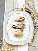 Tasting three different-flavored oysters