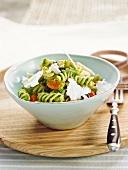 Fusilli with pesto, tomato, parmesan and black olive salad