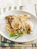 Chicken breasts stuffed with stewed onions, braised chicory
