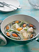 Pan-fried monkfish and mussels in green sauce