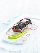 Tuna Ventrèche in a black sesame crust, thinly sliced radishes and wasabi sauce