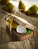 Pear and goat's cheese in a wooden box