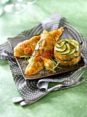 Roasted capon with herbs, zucchini and chestnut savoury cake