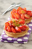 Strawberry-pistachio tartlets