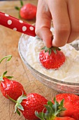 Dipping a strawberry in whipped Fromage blanc