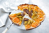 Apricot,quetsch plum and greengage plum tart