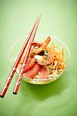 Noodle, shrimp, carrot and pink grapefruit exotic salad