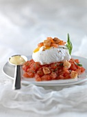 Poached egg with golden croutons and diced salmon with crushed tomatoes