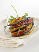 Eggplant and pepper lasagnes with herbs
