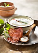 Cream of potato soup with smoked streaky bacon foam and crisp bacon slices
