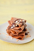 Chocolate crepes with thinly sliced almonds