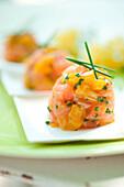 Salmon tartare with mango and Pastis