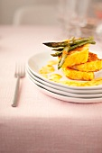 French toast with green asparagus and orange-flavored white butter sauce