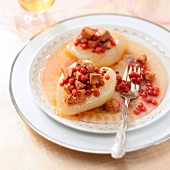 Pears garnished with foie gras and cranberries