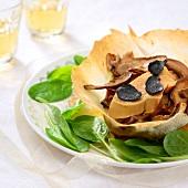 Crisp tulipe garnished with mushrooms and foie gras