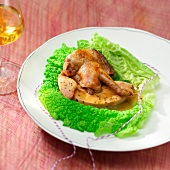 Pigeon and foie gras cooked in a curly cabbage leaf