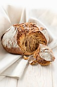 Round rye bread loaf by Gontran Cherrier