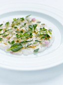 Monkfish carpaccio with mango,citrus fruit oil and yuzu vinaigar