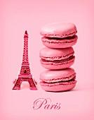 Drei rosa Macarons neben kleinem Eiffelturm (Paris)