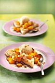 Crepes with diced mango, thinly sliced almonds and vanilla ice cream