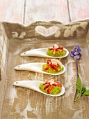 Guacamole, strawberry and thinly sliced fresh almond appetizers