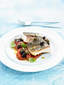 Roasted sea bream with tomatoes and olives