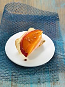 Cow's milk cheese on a slice of bread and topped with a slice of nectarine