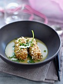 Foie gras and popcorn croquettes,creamy chicken sauce with herbs