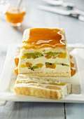 Almond cream and fresh fruit terrine with apricot coulis
