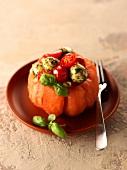 Caprese salad served in a Coeur de boeuf tomato