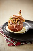 Onion stuffed with duck confit and chanterelles