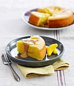Slice of lemon and banana Haribo candy soft cake with Speculos ginger biscuit sauce