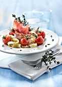 Tagliatelles with cherry tomatoes,confit garlic,thyme and raw ham