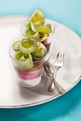 Goat's cheese and beetroot ice cream topped with thinly sliced cucumber rolls