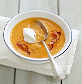 Cream of pumpkin soup with Fromage frais and crisp bacon