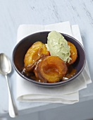 Roasted apricots in toffee sauce with pistachio ice cream