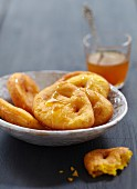 Sopaipillas with sugar,honey and orange syrup