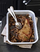 Veal chop with mushrooms and gravy