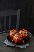 Tomatoes stuffed with chicken,onions and pine nuts