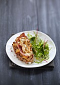 Stewed apple, bacon and breaded Camembert open sandwich
