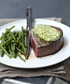 Rare steak with parsley butter and green beans