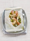 Dublin Bay prawns with fresh mint, spring onions and lime cooked in wax paper